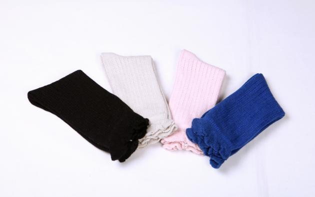 Women's breathable pointelle crew socks with ruffle edge