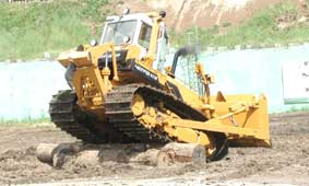 Tractor for land reclamation jobs with dozer and ripping equipment CHETRA 11M