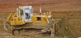 Tractor for land reclamation jobs with dozer and ripping equipment T-15.01M